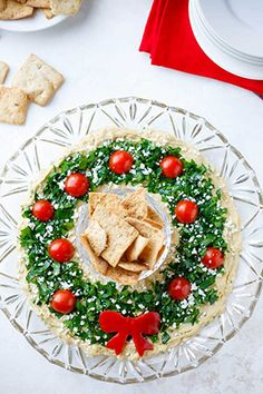 "A super-easy showstopper! This ""Hummus Wreath"" Christmas appetizer recipe is. A super-easy showstopper! This ""Hummus Wreath"" Christmas appetizer recipe is quick and simple, Holiday Appetizers Christmas Parties, Christmas Party Food, Thanksgiving Appetizers, Appetizers For Party, Appetizer Ideas, Appetizer Recipes, Christmas Treats, Easy Make Ahead Appetizers, Simple Appetizers"
