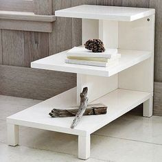 DIY Coffee Tables - Modern Steps  The bones of this side table project are simple and straightforward—you may even be able to find enough material in your leftover scraps to assemble it. Take this austere look to the next level by painting the table in a bold or bright hue.