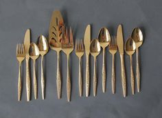 Gold Flatware Service for 3 with Serving Utensils, 14 Pieces. $84.00, via Etsy.