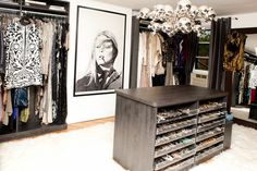A spare room becomes dressing room extraordinaire for the fashion lover with a large wardrobe. Center island has pull-out trays on both sides, lined in velvet with matte Lucite faces, for an extensive jewelry collection.