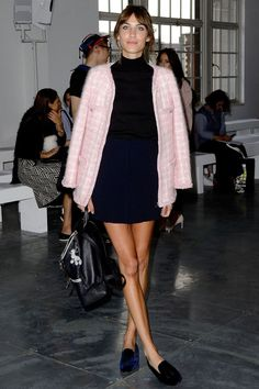 At the A/W '15 House of Holland show at London Fashion Week, Alexa Chung made a typical sartorial splash in this high-neck muted navy mini dress and shoulder-robed pink Chanel boucle jacket. And as ever, we#re loving her work.