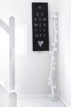 The' welcome to us' sign and the white painted branch with white ball(lights) are DIY. Very simple, but ever so lovely.