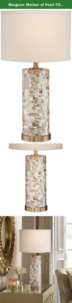 Margaret Mother of Pearl Tile Cylinder Table Lamp. Mother of Pearl tiles over a cylinder of glass combined with a creamy linen shade create a stunning table lamp that makes a statement in any room. Brushed bronze details enhance the warm sparkle and shine. From the 360 Lighting collection of table lamps. - Mother of Pearl over glass construction. - Cream linen drum shade. - A luxe table lamp design. - Maximum 150 watt bulb (not included). - As with any handmade product, each lamp will…