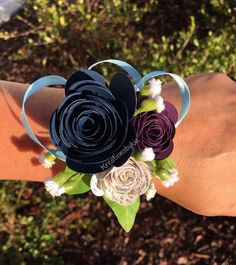 Perfect for a Wedding wrist corsage or Prom corsage There is nothing better than a keepsake. Treasure your beautiful day with these momentos. This beautiful wrist corsage are sweet and simple yet elegant! These are made fresh daily. Perfect for your weddings, proms or a special event! You will receive: 1 Wrist Corsage The corsage is adorned with beautiful paper origami flowers and paper rosette on a matching satin ribbon that easily wraps around your wrist. Colors pictures: Navy, Burgundy…