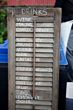 Use an old shutter to display drink menu for your rustic country wedding bar.
