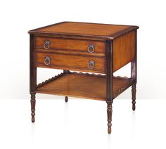 An antiqued and sable bordered lamp table, the square top above two cockbeaded frieze drawers fitted with brass loop handles, the recessed panel carved supports joined by an undertier with an undulating gallery, on turned and fluted legs. The original French Provincial.