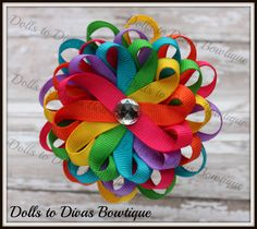 Loopy Ribbon Flower Hair Bow Clip - Bright Rainbow Ribbon Loop Flower in Shocking Pink, Orange, Yellow, Apple, Turquoise and Dark Lavender. $5.99, via Etsy.
