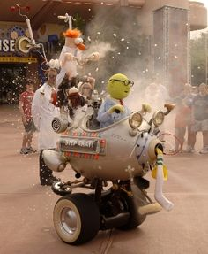 """""""The Muppet Mobile Lab goes out for a test spin with Dr. Bunsen Honeydew and Beaker rolling about Epcot's Future World."""""""