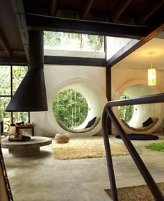 Totally of an era - a concrete crash pad, with exposed wooden beams, stucco walls, wall-to-wall carpeting and an open 360 degree fireplace. Awesome.