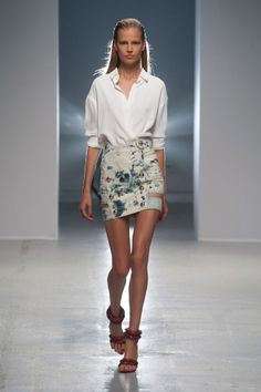 Anthony Vaccarello Spring 2014. Floral Mini skirt, white blouse and killer heels