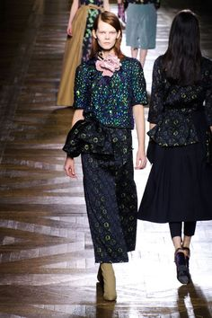 The shapes were understandable but van Noten added tiny flounces like asymmetric peplums, bouquets at the collar and bustled overskirts that, while pulled from centuries' past, felt of the moment.