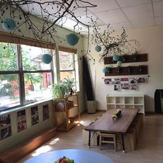 Boulder Journey School - Reggio Emlila - Love that hanging art piece. also the hanging mason jars, the picture display, the table, the boxes/chairs.- Via Fairy Dust Teaching