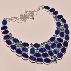 Add an elegant touch of sparkle to a special evening with this stunning necklace. Featuring Lapis Lazuli, and Amethyst in a very unique design, in a .925 sterling silver setting for the ultimate in gl