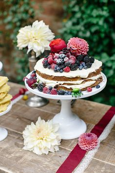 Naked cake topped with flowers and berries