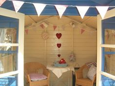 I'd love to have a summer house in my garden just like this! Perfect covered spot for food or getting out of the sun during a backyard party! Summer Sheds, Summer Garden, Beach Hut Shed, Beach Huts, Fresco, Summer House Interiors, Craft Shed, Wendy House, Garden Buildings