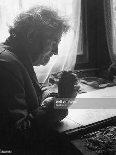 English painter, war artist, occultist and joint editor of the 'Golden Hind' art quarterly, Austin Osman Spare (1886 - 1956), at work at his flat in Brixton, South London, 1953. Original Publication: Picture Post 6627 - Austin Osman Spare - unpub - 1953
