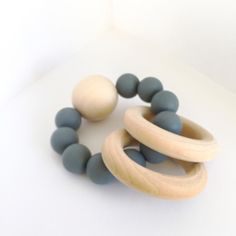 Natural Wood  Silicone Baby Teether - Grey Burly Awesome for little ones that have emerging teeth and natural mamas that care about the nasties and other things that can be added into products.