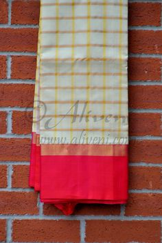 Cream Kuppadam Saree with Yellow/Copper checks all over and Pink/Copper Borders