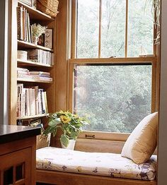 This tiny bench reading nook is situated perfectly: next to a window and a bookshelf. It's a bookworm's miniature paradise!