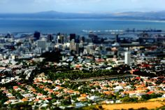 Tilt-shift photography is a method of using a tilt-shift lens to create an image that looks like it is being viewed from a larger perspective. Tilt Shift Lens, Tilt Shift Photography, Photojournalism, Perspective, Dolores Park, That Look, Culture, Chameleon, City