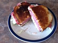 New Yorker! Pastrami, cole slaw, Swiss cheese and thousand island dressing on the grilled...can you say Heaven!