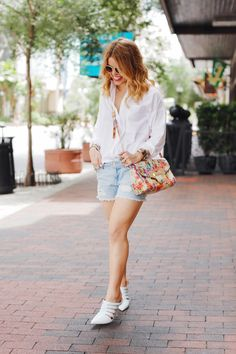 How to Elevate Your Weekend Fashion Basics | The Everygirl | white button down + denim shorts + white shooties  = simple classic summer outfit