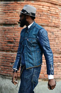 Denim vest over biker jacket.