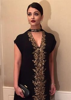 Aishwarya Rai Bachchan takes high fashion to newer levels with her black Sabyasachi salwar kameez and strappy heels.