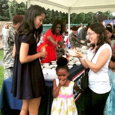 http://www.eonline.com/news/668585/little-girl-cries-and-runs-away-from-michelle-obama-at-military-ice-cream-social-in-italy-see-the-pic