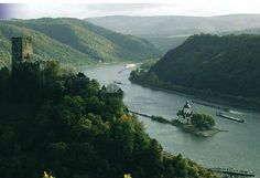 """37 of the 962 sites of """"exceptional natural and cultural importance"""" on the UNESCO-World Heritage List are in Germany.    One of Germany's sites is the Upper Middle Rhine and this photo is of the bend in the River Rhine between Kaub and Bacharach. Gutenfels Castle sits on a rock above the small town of Kaub. In the middle of the river is Pfalzgrafestein, Castle Pflaz, the former toll castle (customs post for passing river traffic) of the Palatine Electors. Soonwald Forest is on the horizon."""