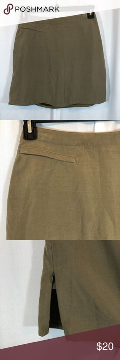 """Patagonia Olive Green Hiking Skort/Skirt, Size 4 NOTE: There is a tiny red dot/mark on the front thigh area of this skirt. Please see photos for details.  Brand: Patagonia Size: 4 Material: 100% Polyester Condition: Pre-owned in good condition with no rips or tears  Approx. Measurements Waist: 26"""" Length: 16.5"""" Patagonia Skirts"""