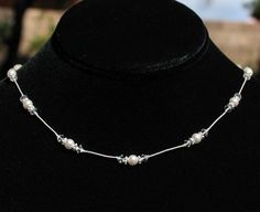 Simple and Sweet Swarovski  Pearl and Crystal Necklace on Silk Thread | by Handmade by Diana