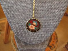 Gold tone fixed drop cloisonne necklace with ornate drop on back and matching shepherd hook earrings