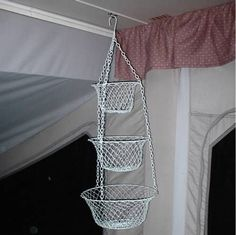 Mount a hanging basket from a hook to store random items. | 44 Cheap And Easy Ways To Organize Your RV/Camper