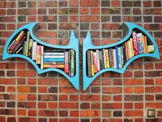 Batman: Arkham Asylum: For the ultimate Batman fan, this aluminum and MDF Batman bookshelf ($278) is the way to go! If nothing else, it's a great place to store your comic books!