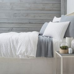 Pine Cone Hill Tidal White Duvet Cover. If you're a sucker for subtle texture, you'll love this cotton duvet cover featuring a puckered stripe reminiscent of classic seersucker. Layer this duvet with deep blues and stripes for a traditional look, or add in a fleece blanket and chunky knit throw for the ultimate comfort.