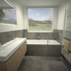 Badkamer met ligbad en douche met glazen wand