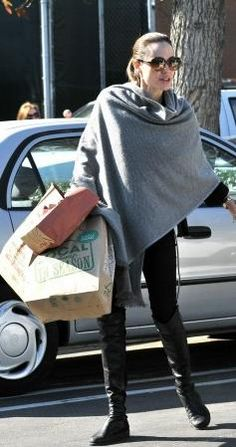 over the knee boots on Angelina Jolie  source: outfitidentifier.com