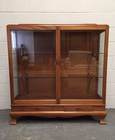It is in excellent condition and due to its size is quite a striking piece of furniture. It has 2 drawers at the bottom of the unit. The glass shelves sit on very elegant wooden brackets. 2 people would be required to unload it. | eBay!