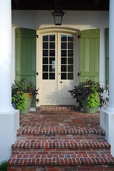 The brick, the cream color on the doors, and the green shutters. Green Shutters, Shutters Inside, Cottage Shutters, Louvered Shutters, Wooden Shutters, Br House, Brick Steps, Entry Doors, Front Entry