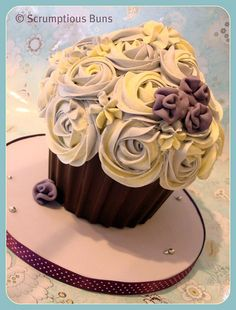 I want different kinds of giant cupcakes instead of wedding cake or normal cupcakes for my wedding. Giant Cupcake by Scrumptious Buns (Samantha), via Flickr
