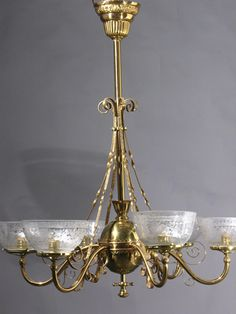 This is a great example of East lake detailing in 1870. The rose brass shows off in a 25 year old polished and lacquered finish. The banding has a stamped design on this light and surrounds the arms on the top and the bottom. Wonderful oil/gas shades with etched design of a garden scene. The super large ball body compliments the large scale of this fixture. And what a canopy. Wow!! $5130.00 - SOLD