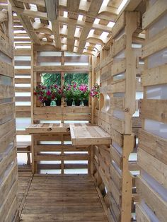 "Pallet based shed. Called a ""house for refugees,"" made from 100 shipping pallets. Pallet Shed, Pallet House, Pallet Bar, Pallet Benches, Pallet Tables, Old Pallets, Wooden Pallets, Wooden Boards, Pallet Crafts"