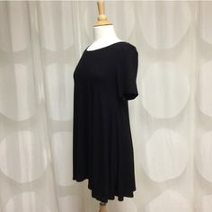 NEW Adorable Black Dress In love with this adorable dress! Casual, black, made in USA, round neck, sleeve, 96% rayon 4% spandex available in SMALL. April Spirit Dresses Mini