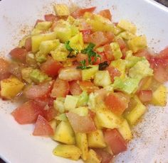 Colorful salad mango avocado tomato