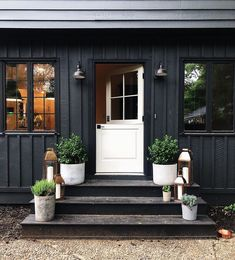 We're suckers for a black house and a dutch door, so this front step from is hitting all the marks. Dream Home Design, My Dream Home, House Design, Roof Design, Future House, Front Door Steps, Front Doors, Aesthetic Rooms, Backyard Patio