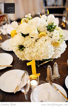 Some of the tables will have low square vases filled with cream hydrangeas, grey dusty miller, yellow craspedia, yellow spray rose, yellow James Story orchids, and yellow tulips surrounded by silver mercury glass votives.