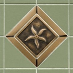 """4"""" Solid Bronze Wall Tile with Starfish Design - With 6"""" Tile Frame - Burnished Bronze by Whittington Collection. $78.95. Accent your kitchen or bath tile with this charming 4 accent tile. Made of solid bronze, it features a starfish design and is offered with an optional tile frame for a custom look. Made of solid bronze. Measures 4-1/4 L x 4-1/4 W. Tile is 3/8 thick. Available with optional tile frame. (See multi image view). Tile frame measures 6 L x 6 W. Frame o..."""