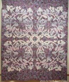 Paokalani African Tulips by Karin Crawford, quilted by Pat Gorelangton.  Design by John Serrao.  Photo by Quilt Inspiration:  2015 Springville (Utah) quilt show.