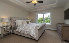 Large Master Suite Bedroom with enough room for your upholstered king sized bed, two night stands, a dresser, a reading chair and table (not shown).  Created by Dynasty Partners Homes new construction homes. #home #design #interior #decor #build #desmoines